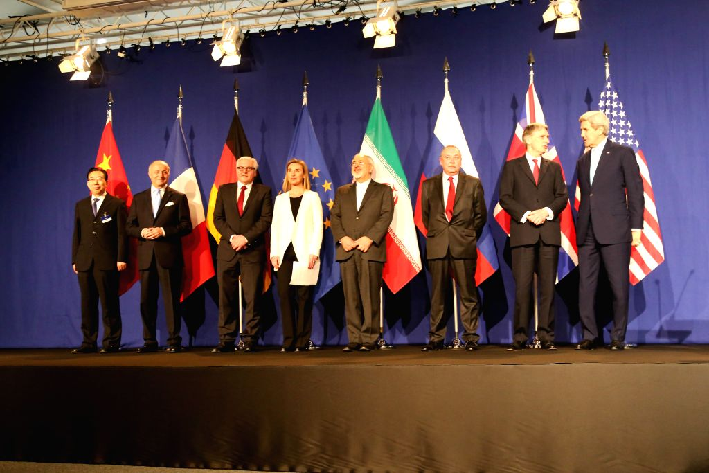 Representatives from the P5+1 countries, European Union (EU) and Iran pose for photos in Lausanne, Switzerland, on April 2, 2015. Top negotiators on Thursday ...