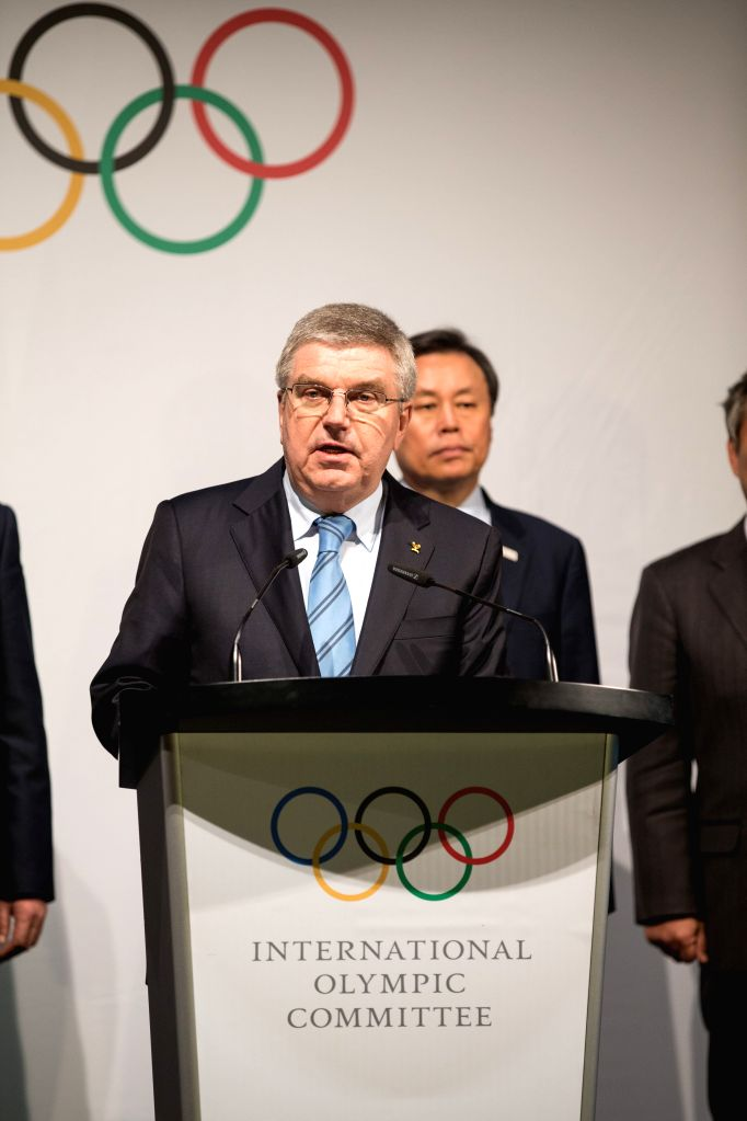 LAUSANNE, Jan. 20, 2018 - International Olympic Committee (IOC) President Thomas Bach (Front) speaks during a ceremony after a four-party meeting at the IOC headquarters in Lausanne, Switzerland, ...
