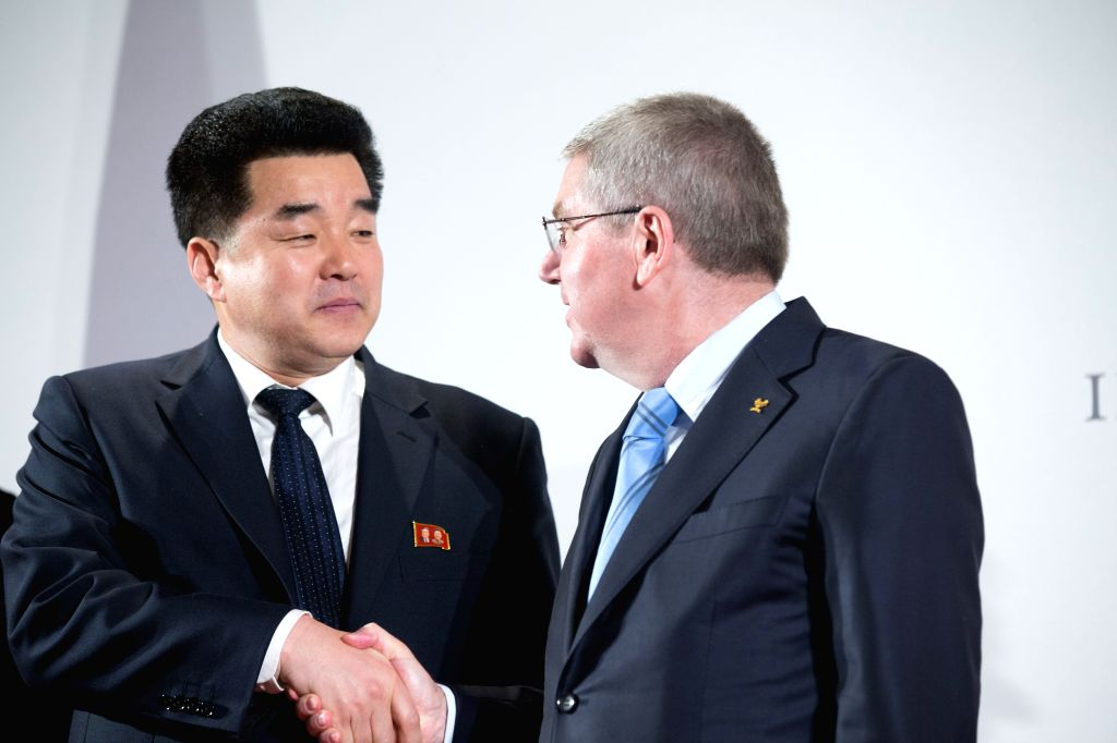 LAUSANNE, Jan. 20, 2018 - International Olympic Committee (IOC) President Thomas Bach (R) shakes hands with Kim Il Guk, the president of the Olympic Committee of the Democratic People's Republic of ...