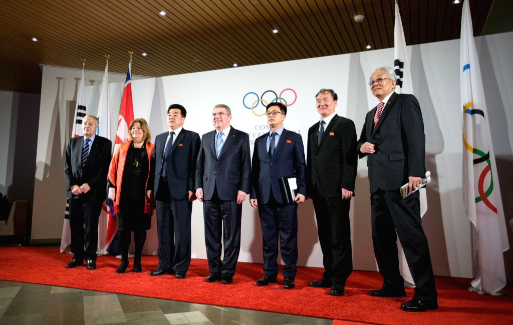 LAUSANNE, Jan. 20, 2018 - International Olympic Committee (IOC) President Thomas Bach (C) poses with Kim Il Guk (3nd L), the president of the Olympic Committee of the Democratic People's Republic of ...