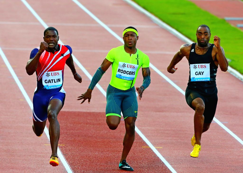 (From L to R) Justin Gatlin, Michael Rodgers and Tyson Gay of the United States compete during the men's 100m race during the IAAF Diamond League Meetings in ...