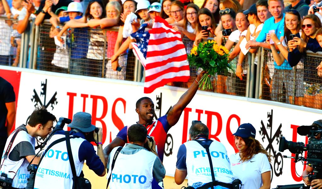 Justin Gatlin (C) of the United States celebrates after the men's 100m race during the IAAF Diamond League Meetings in Lausanne, Switzerland, July 3, 2014. Justin ..