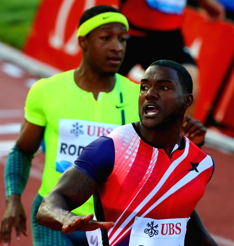 Justin Gatlin (front) of the United States crosses the finishing line during the men's 100m race during the IAAF Diamond League Meetings in Lausanne, Switzerland, ..