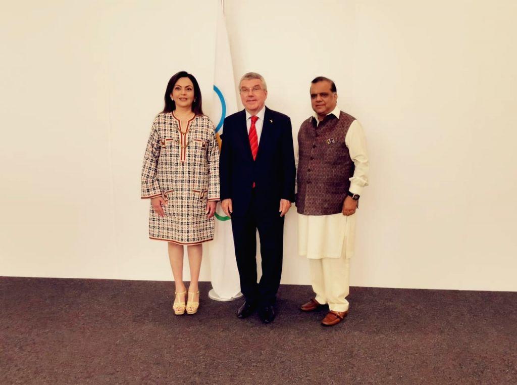 Lausanne: (L-R) International Olympic Committee member Nita Ambani, IOC President Thomas Bach and Indian Olympic Association President Narinder Batra during the 134th Session of governing body in Lausanne, Switzerland. (Photo: IANS) - Nita Ambani