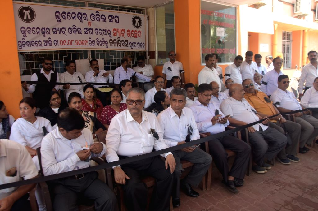 Lawyers??? body of Odisha State Administrative Tribunal (SAT) observe a one-day cease-work stir protesting against its abolition by the Union Government recently; in Bhubaneswar, on Aug ...