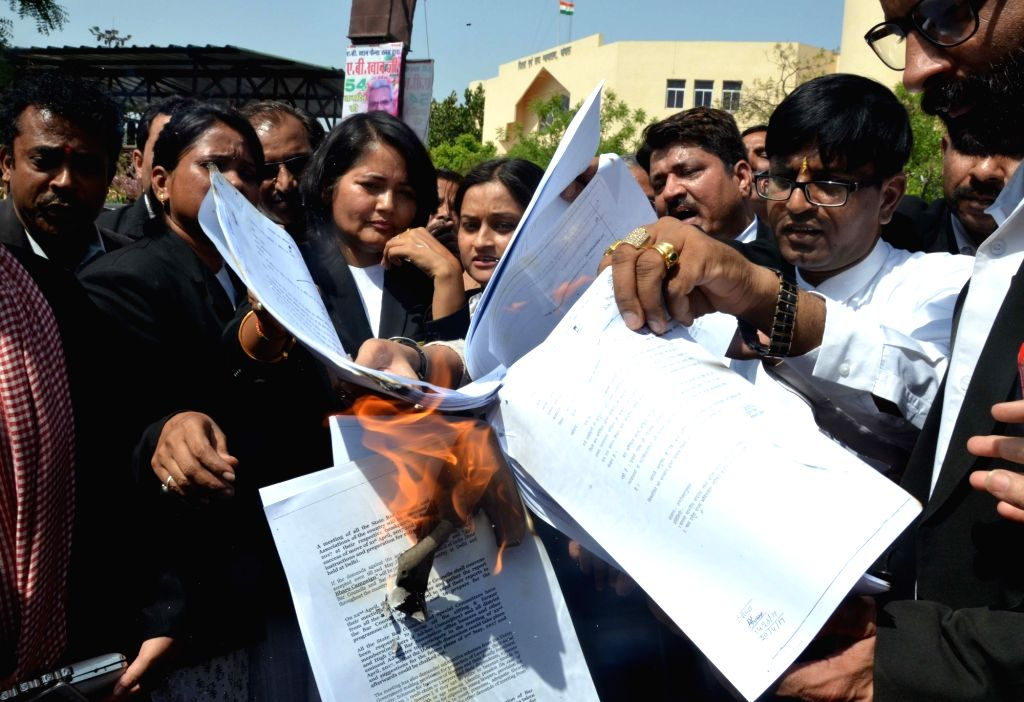 Lawyers burn copies of Advocates Act (Amendment) Bill 2017 to protest against Law Commission recommendations, including a proposal to ban strikes by advocates in Bhopal on April 21, 2017.