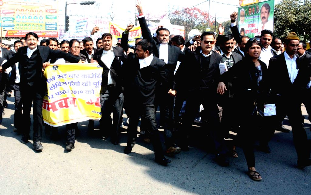 Lawyers participate in a march to press for their various demands in Patna, on  Feb 12, 2019.