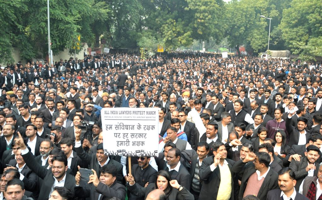 Lawyers stage a demonstration outside Patiala House Courts to press for their demands in New Delhi on Feb 12, 2019.