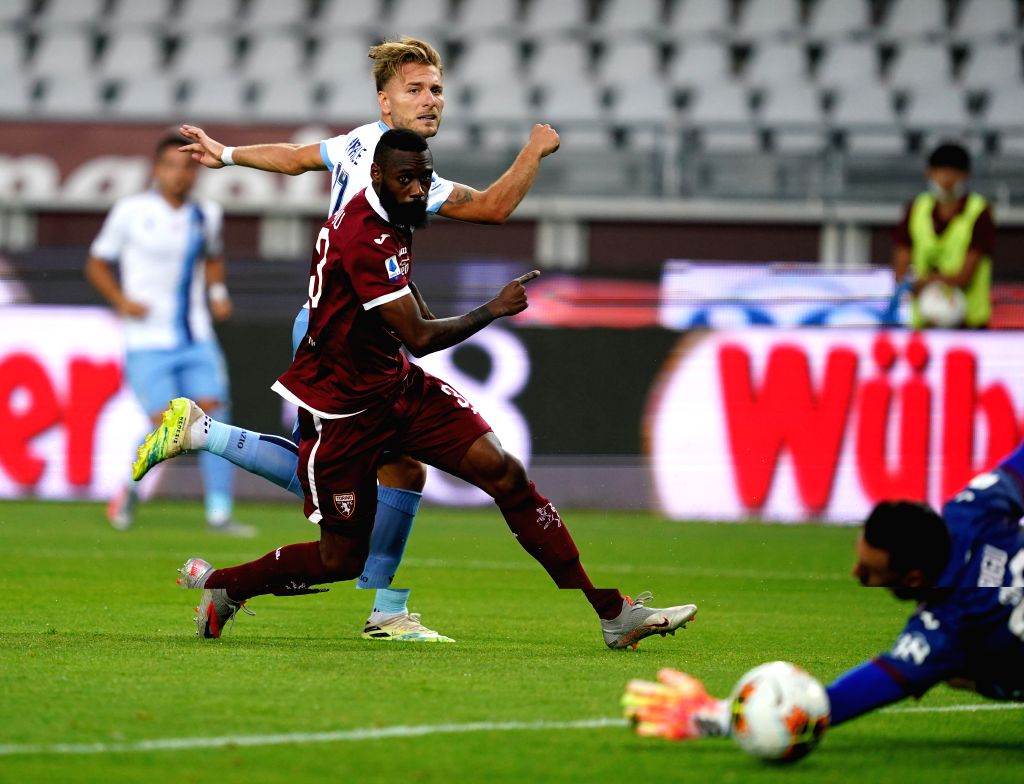 Lazio's Ciro Immobile (front L) scores his goal during a Serie A football match between Torino and Lazio in Turin, Italy, June 30, 2020.