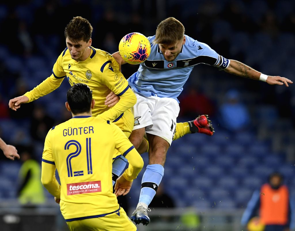 Lazio's Ciro Immobile (R, top) vies with Hellas Verona's Marash Kumbulla (L, top)) during a Serie A soccer match between Lazio and Hellas Verona  in Rome, Italy, Feb. ...