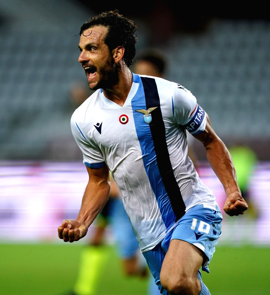Lazio's Marco Parolo celebrates his goal during a Serie A football match between Torino and Lazio in Turin, Italy, June 30, 2020.