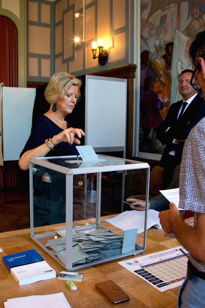 LE BOUQUET, June 18, 2017 - A woman votes during the second round of the parliamentary election at the city hall of Le Touquet, France on June 18, 2017.