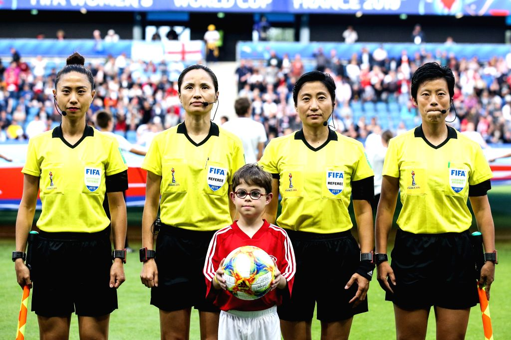 LE HAVRE, June 15, 2019 - Chinese referee Fang Yan (1st R) and Qin Liang (2nd R) reacts before the FIFA Women's World Cup 2019 Group D match between England and Argentina in Le Havre, France, June ...