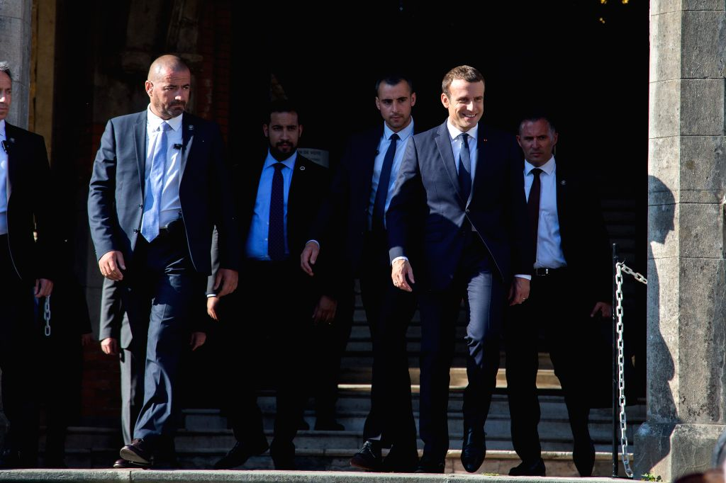 LE TOUGUET, June 18, 2017 - French President Emmanuel Macron (R) walks out of the city hall in Le Touquet, France on June 18, 2017. Parliamentary election continued in France where more than 47 ...