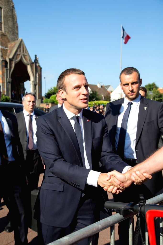 LE TOUGUET, June 18, 2017 - French President Emmanuel Macron greets his supporters after he voted at the city hall in the second round of the parliamentary elections in Le Touquet, France on June 18, ...