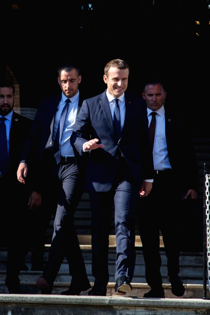 LE TOUQUET (FRANCE), June 18, 2017 French President Emmanuel Macron (C) walks out of a building after he voted at the city hall in Le Touquet, France on June 18, 2017. French President ...