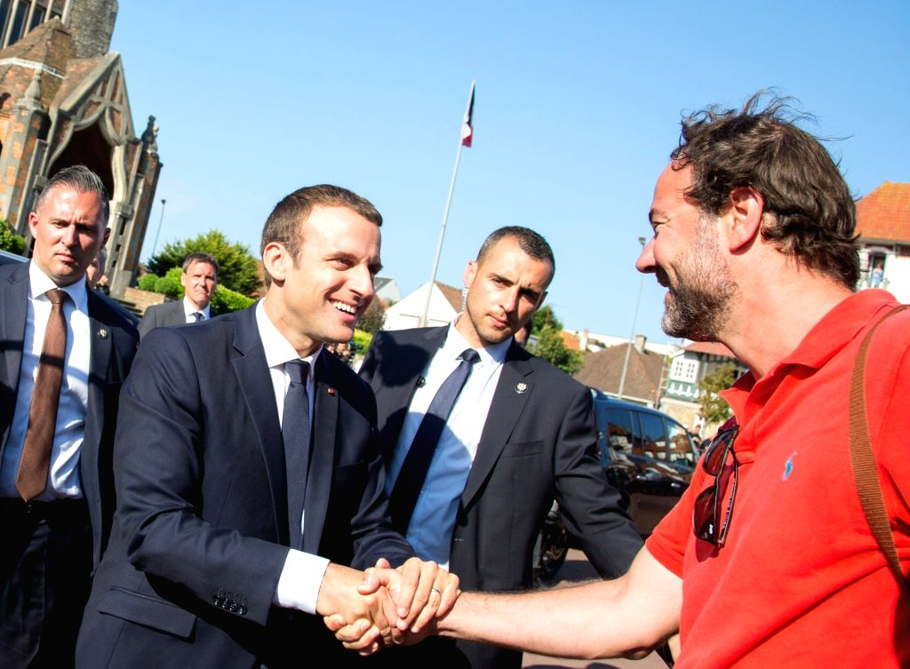 LE TOUQUET (FRANCE), June 18, 2017 French President Emmanuel Macron (L, front) greets his supporter after he voted at the city hall in Le Touquet, France on June 18, 2017. French ...