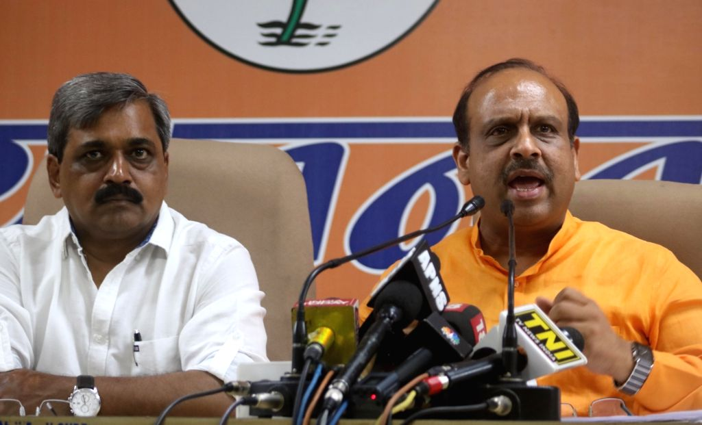 Leader of the opposition in the Delhi Assembly Vijender Gupta addresses a press conference in New Delhi, on June 3, 2016. Also seem Delhi BJP chief Satish Upadhyay. - Assembly Vijender Gupta and Satish Upadhyay