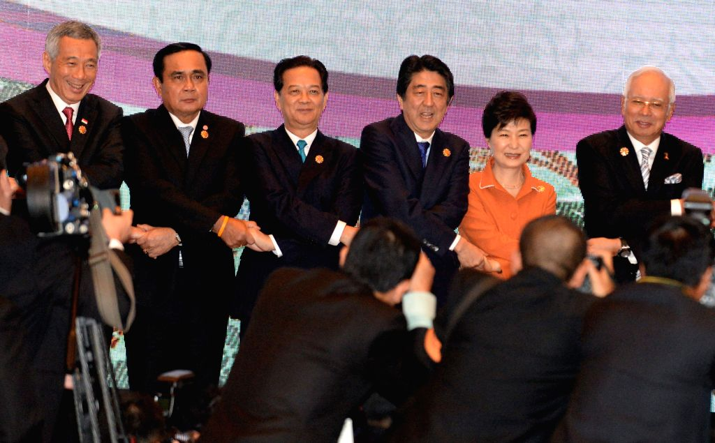 Leaders shake hands during the 18th Association of Southeast Asian Nations (ASEAN)-China, Japan and South Korea (10+3) leaders' meeting in Kuala Lumpur, ...
