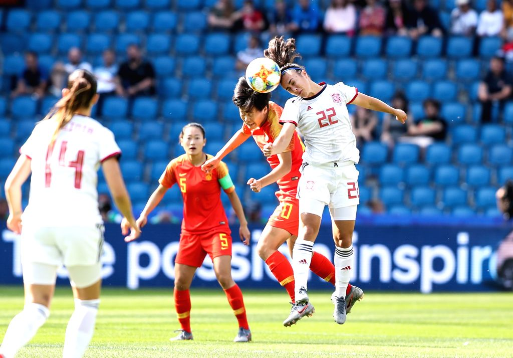 LEAFUER, June 17, 2019 - Zhang Rui (2nd R) of China vies with Nahikari Garcia (1st R) of Spain during the Group B match at the 2019 FIFA Women's World Cup at Stade Oceane in Le Havre, France, June ...