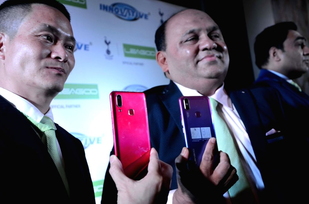 LEAGOO Chief Operating Officer Kevin Liu and Innovative Ideals and services ltd. Director Maqsood Shaikh at the launch of LEAGOO's smartphones, in Mumbai, on April 26, 2019.