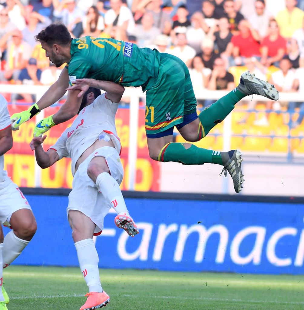 LECCE, Oct. 27, 2019 - FC Juventus's Gonzalo Higuain (L) vies with Lecce's Gabriel during a Serie A soccer match between Lecce and FC Juventus in Lecce, Italy, Oct. 26, 2019.