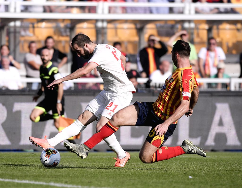 LECCE, Oct. 27, 2019 - FC Juventus's Gonzalo Higuain (L) vies with Lecce's Fabio Lucioni during a Serie A soccer match between Lecce and FC Juventus in Lecce, Italy, Oct. 26, 2019.