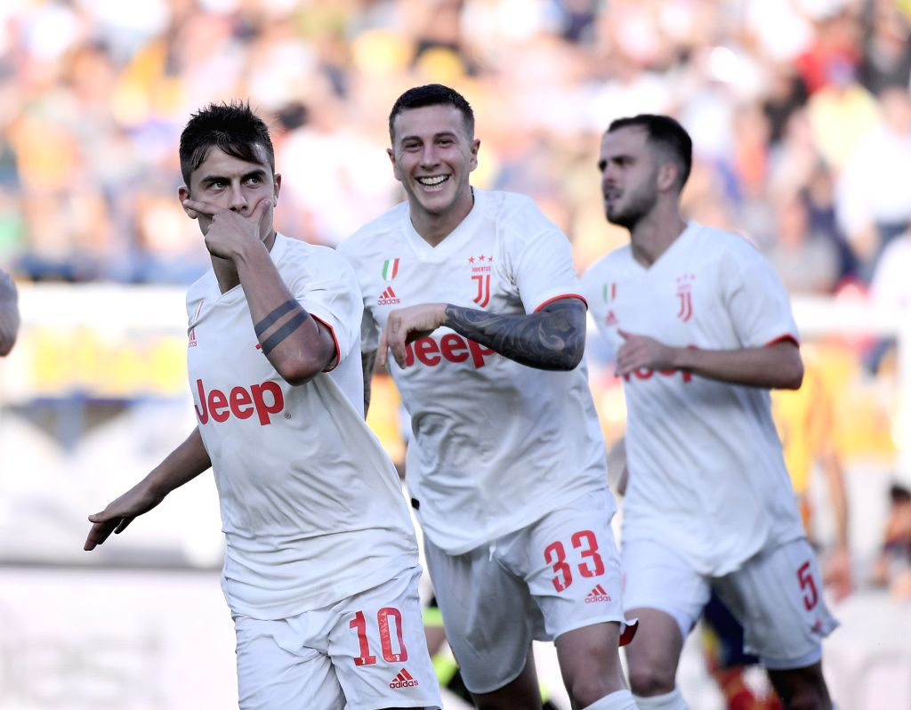 LECCE, Oct. 27, 2019 - FC Juventus's Paulo Dybala (L) celebrates during a Serie A soccer match between Lecce and FC Juventus in Lecce, Italy, Oct. 26, 2019.