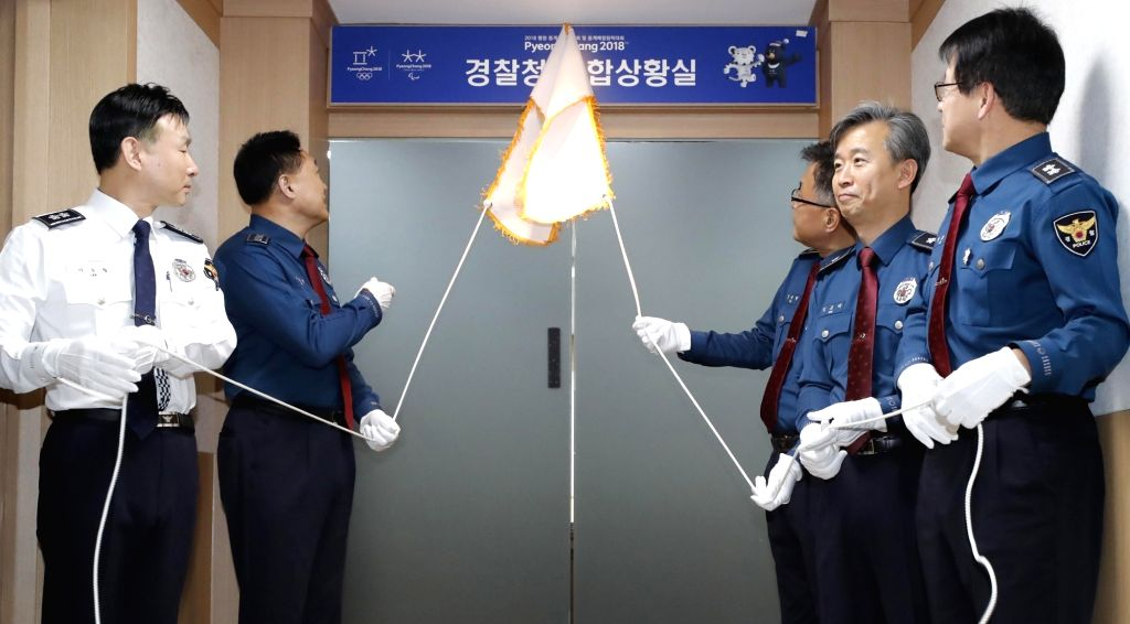 Lee Cheol-seong (2nd from L), head of the National Police Agency (NPA), attends a ceremony at the NPA headquarters in Seoul on Feb. 1, 2018, to open a situation room for the PyeongChang Winter ...