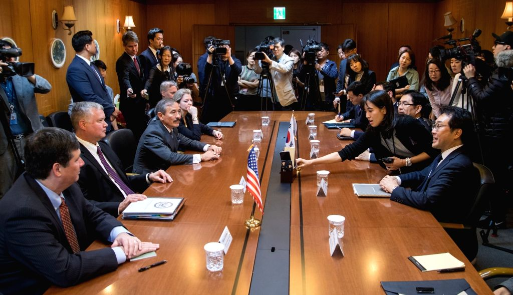 Lee Do-hoon (R), South Korea's top nuclear envoy, and Stephen Biegun (2nd from L), the new U.S. representative on North Korea policy, get ready to hold talks in Seoul on Sept. 11, 2018. The ...