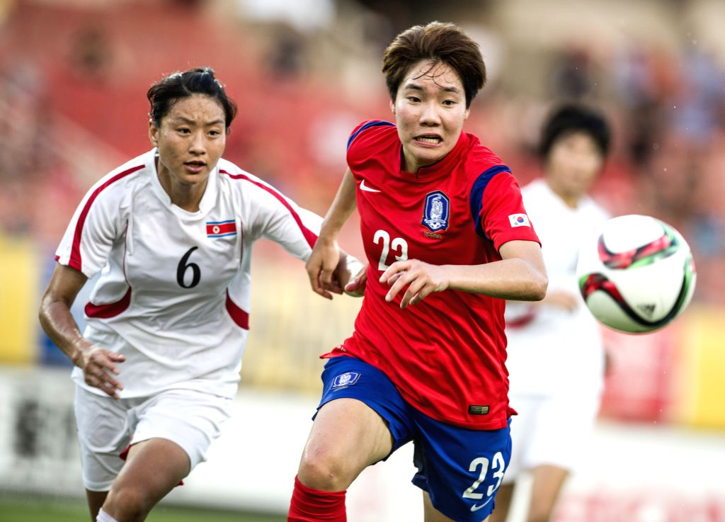 Lee Geum Min(R) of South Korea competes during the match against the Democratic People's Republic of Korea (DPRK) at the 2015 EAFF(East Asian Football Federation) ...