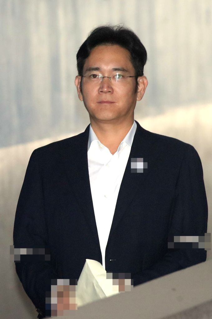 Lee Jae-yong, vice chairman of Samsung Electronics Co., enters the Seoul Central District Court in Seoul on Aug. 2, 2017, to stand trial for alleged bribery related to the merger of two of ...