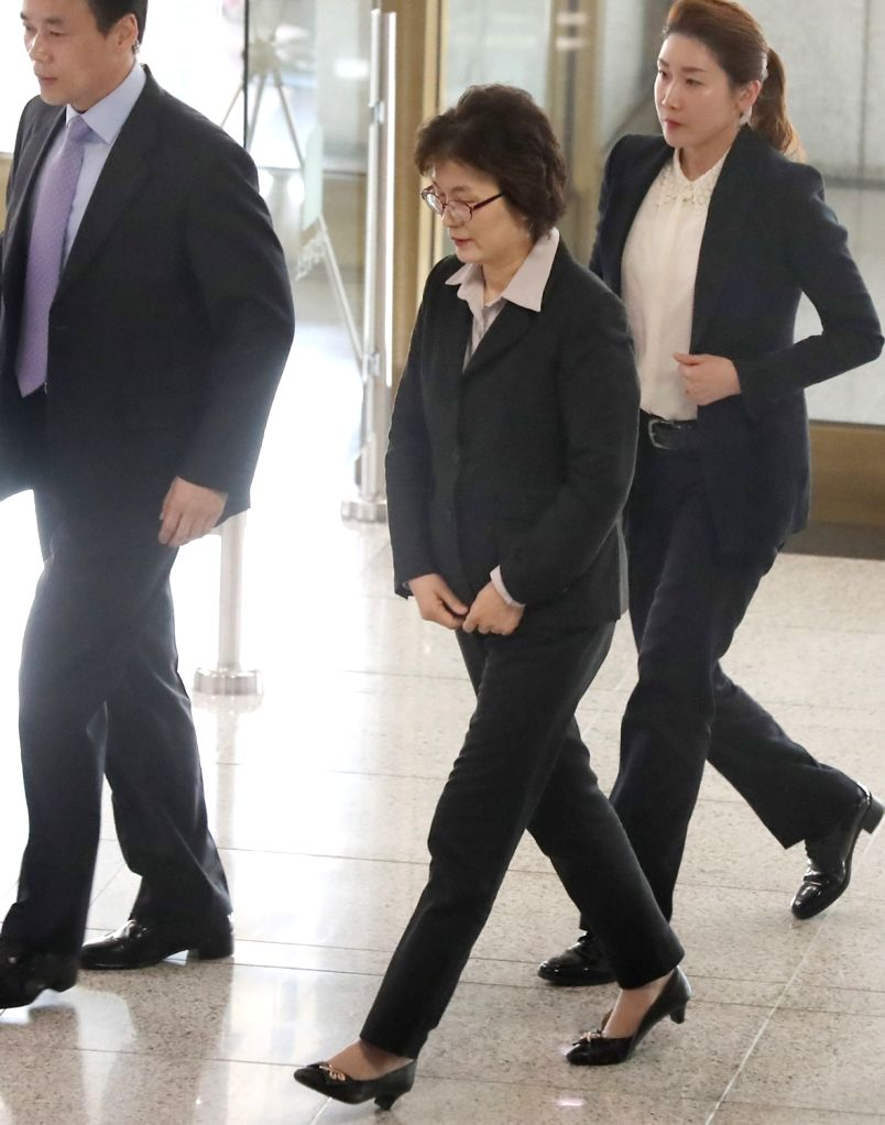 Lee Jung-mi (C), acting chief of the Constitutional Court, arrives at the court in Seoul on March 9, 2017, one day before the court will announce its ruling on the impeachment of President ...