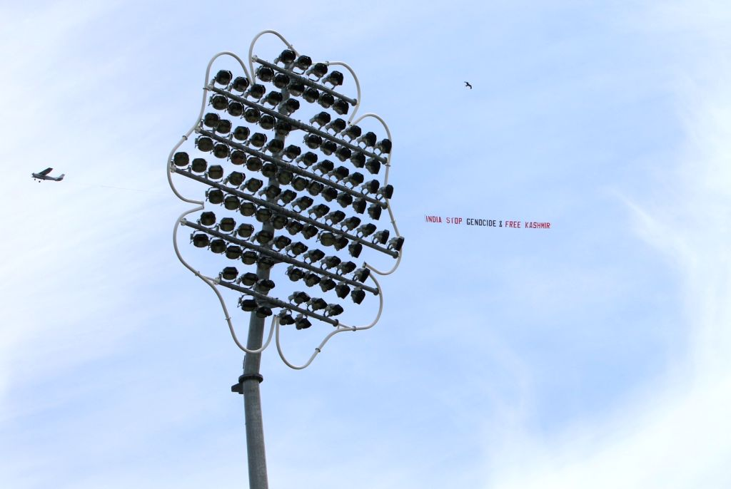 """Leeds: A low flying airplane tows a large aerial banner reading  """"India Stop Genocide & Free Kashmir"""" in the skies above the Headingley Stadium where the 44th match of World Cup 2019 between India and Sri Lanka is underway in Leeds, England on July 6 - Surjeet Yadav"""