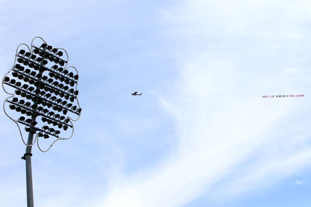 "Leeds: A low flying airplane tows a large aerial banner reading  ""India Stop Genocide & Free Kashmir"" in the skies above the Headingley Stadium where the 44th match of World Cup 2019 between India and Sri Lanka is underway in Leeds, England on July 6 - Surjeet Yadav"