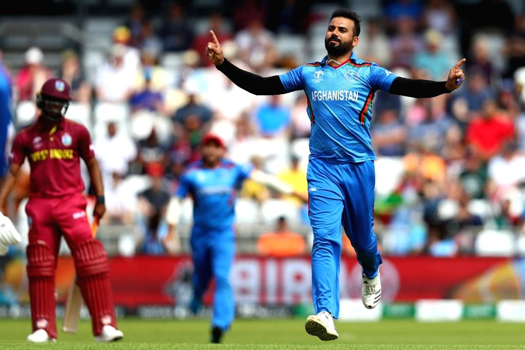Leeds: Afghanistan's Dawlat Zadran celebrates fall of a wicket during the 27th match of 2019 World Cup between West Indies and Afghanistan at Headingley Cricket Ground in Leeds, England on July 4, 2019. (Photo Credit: Twitter/@cricketworldcup)