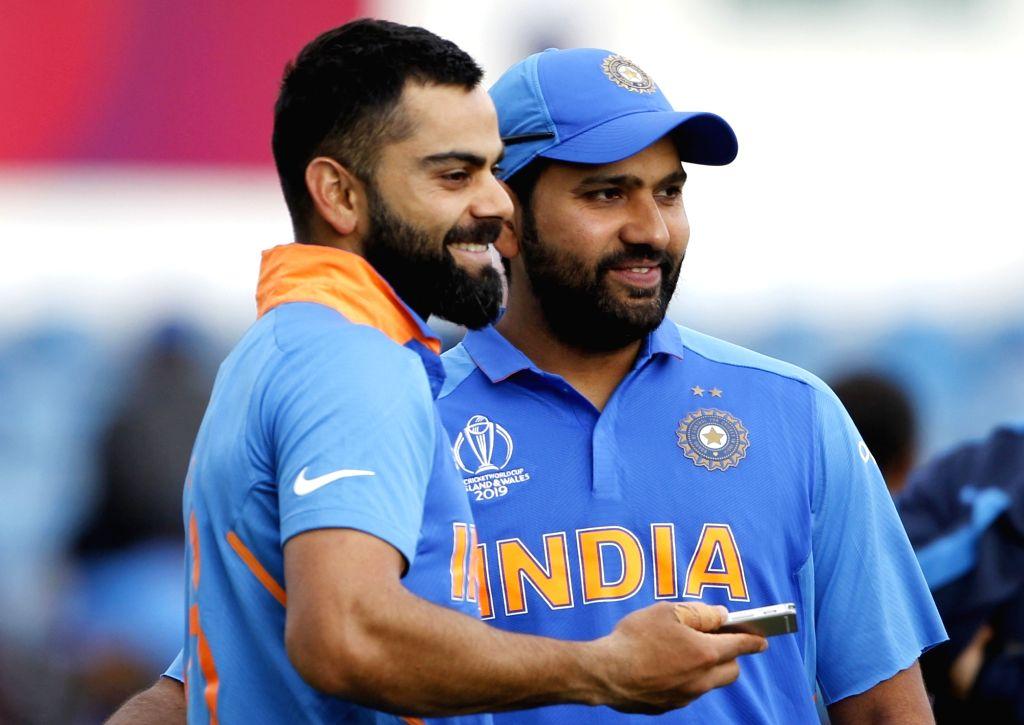 Leeds: India's Virat Kohli and Rohit Sharma after winning World Cup 2019 match against Sri Lanka at Headingley Stadium in Leeds, England on July 6, 2019. (Photo: Surjeet Yadav/IANS) - Virat Kohli, Rohit Sharma and Surjeet Yadav