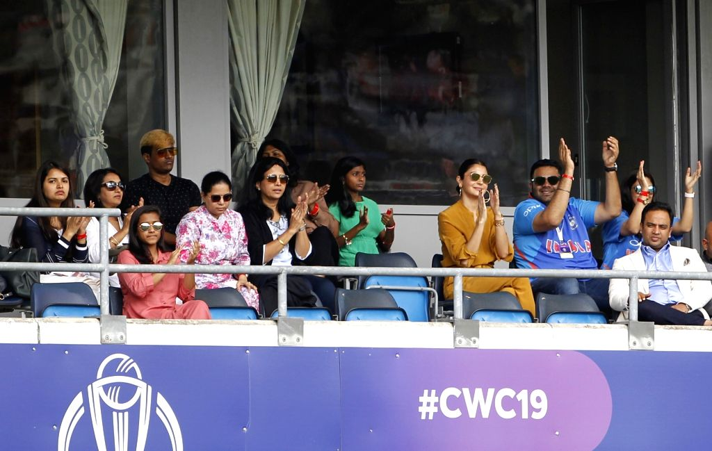 Leeds: Indian captain Virat Kohli's wife actress Anushka Sharma during the 44th match of World Cup 2019 between India and Sri Lanka at Headingley Stadium in Leeds, England on July 6, 2019. (Photo: Surjeet Yadav/IANS) - Virat Kohli, Anushka Sharma and Surjeet Yadav