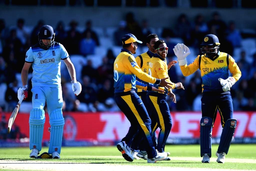 Leeds: Sri Lankan cricketers celebrate after winning the 27th match of 2019 World Cup against England at Headingley Cricket Ground in Leeds, England on June 21, 2019. Sri Lanka won by 20 runs. (Photo Credit: Twitter/@ICC)