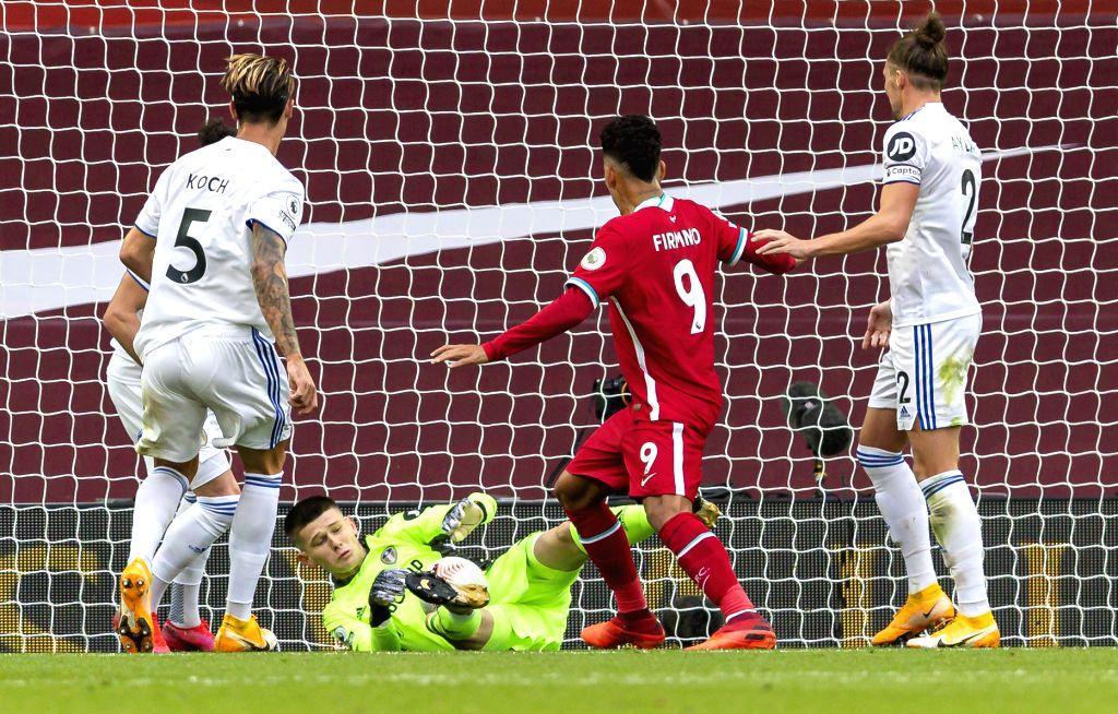 Leeds United's goalkeeper Illan Meslier (bottom) fumbles the ball as Liverpool's Virgil van Dijk scores a goal during the English Premier League match between ...