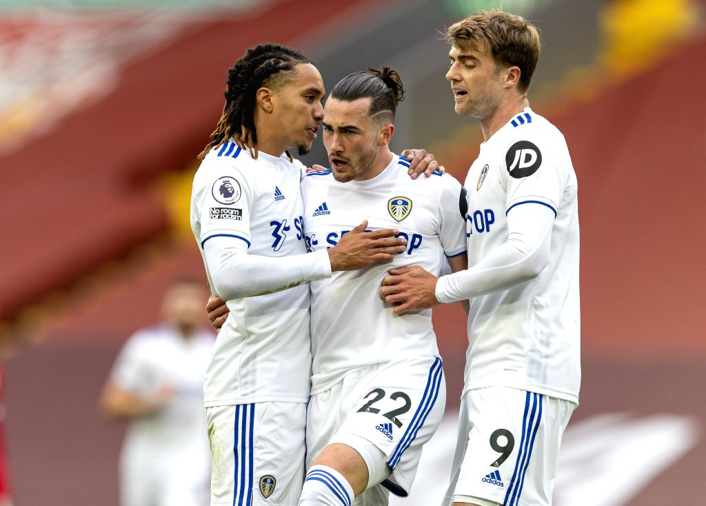 Leeds United's Jack Harrison (C) celebrates scoring with teammates Helder Costa (L) and Patrick Bamford during the English Premier League match between Liverpool ...