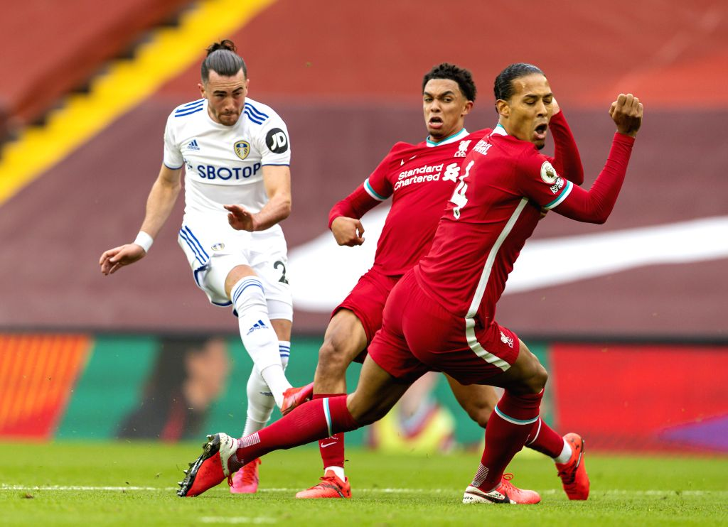 Leeds United's Jack Harrison (L) shoots and scores during the English Premier League match between Liverpool FC and Leeds United FC at Anfield in Liverpool, ...