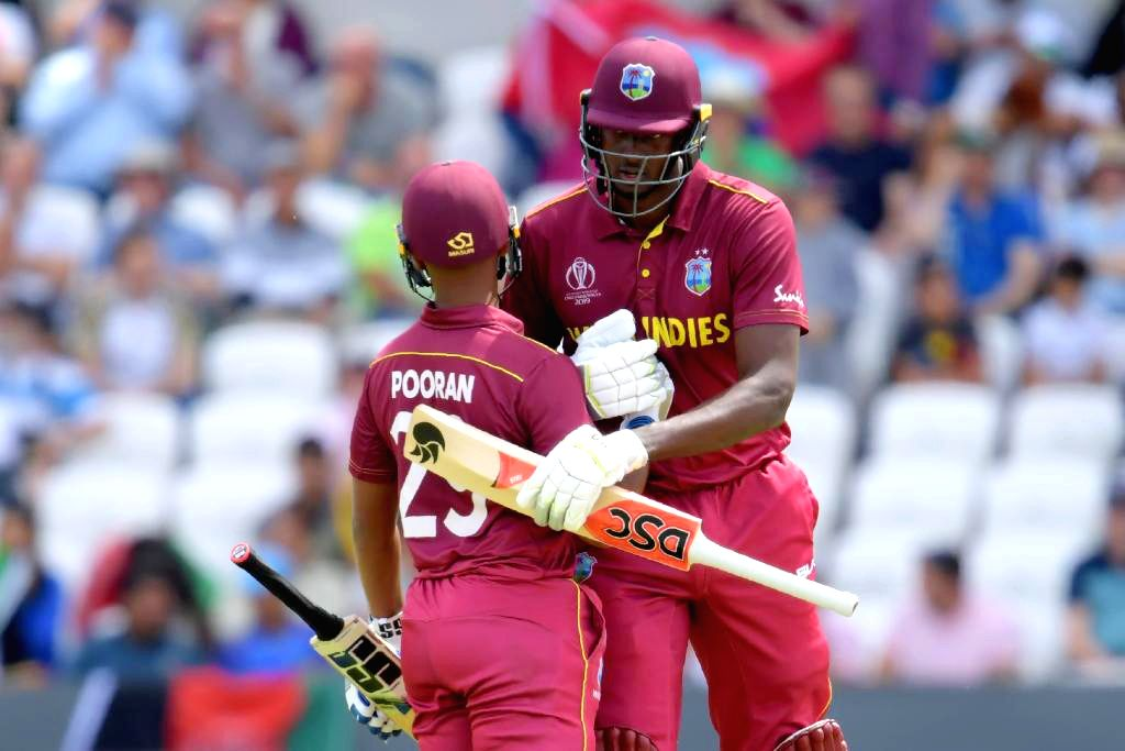 Leeds: West Indies' Nicholas Pooran and Jason Holder during the 27th match of 2019 World Cup between West Indies and Afghanistan at Headingley Cricket Ground in Leeds, England on July 4, 2019. (Photo Credit: Twitter/@cricketworldcup)