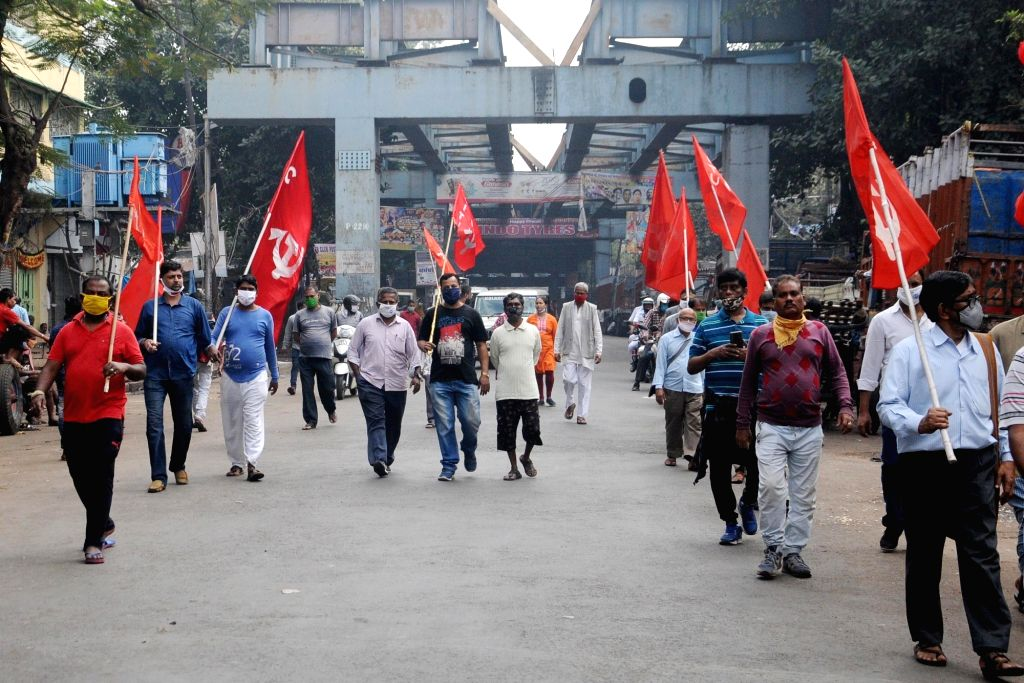 Left activists participate in a protest rally during the 24-hour nationwide trade union strike called by the central trade unions against the central government's new farm and labour laws, ...
