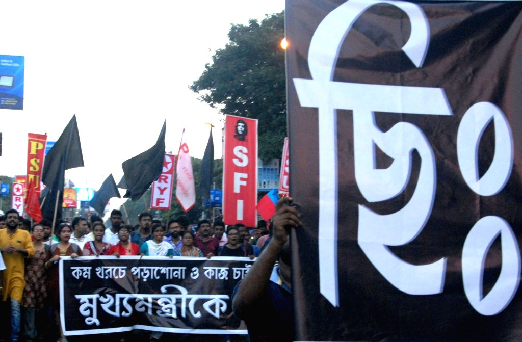 Left activists participate in a rally to protest to against violent police action on students and youth wing activists of the Left parties during Sigur to Nabanna rally; in Kolkata on Sep ...