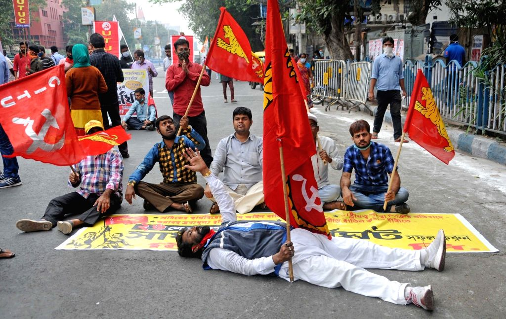 Left and Congress activists block roads as they protest during the 24-hour nationwide trade union strike called by the central trade unions against the central government's new farm and ...