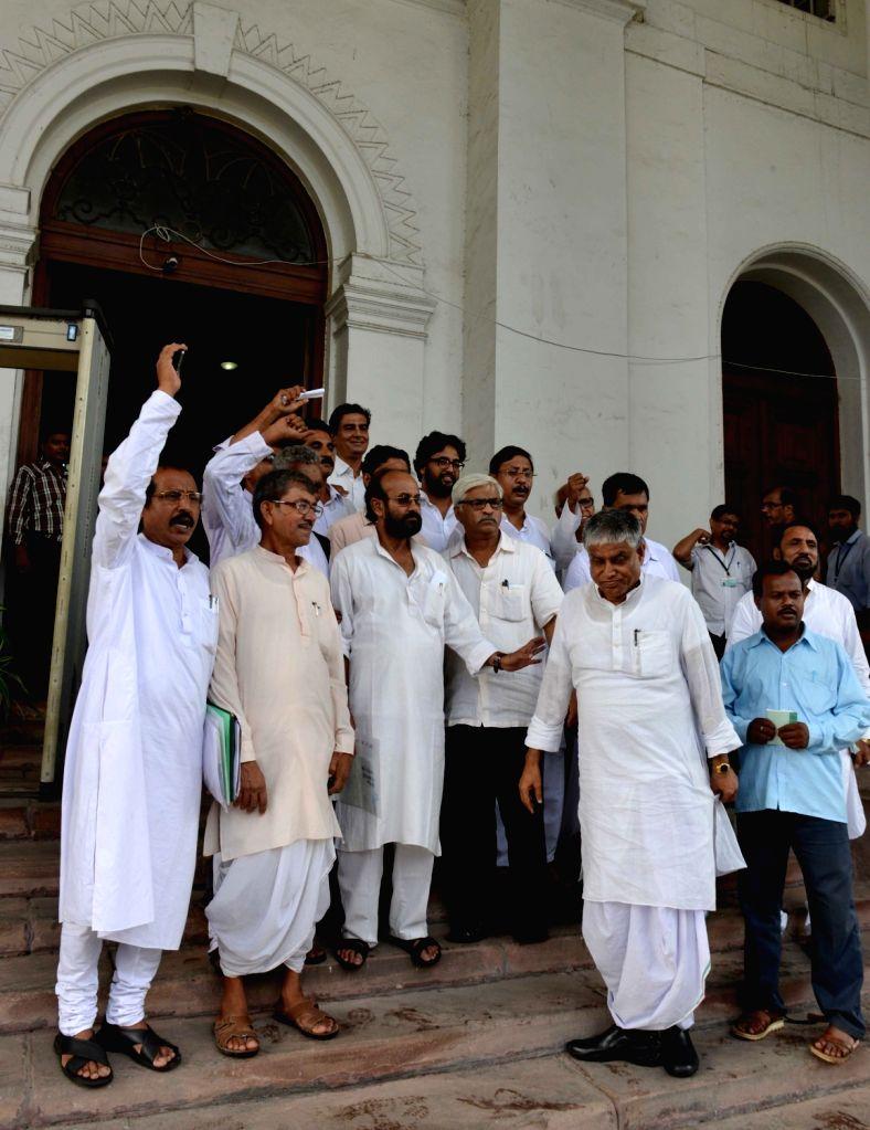Left and Congress legislators walkout of West Bengal Legislative Assembly in Kolkata on June 27, 2016.
