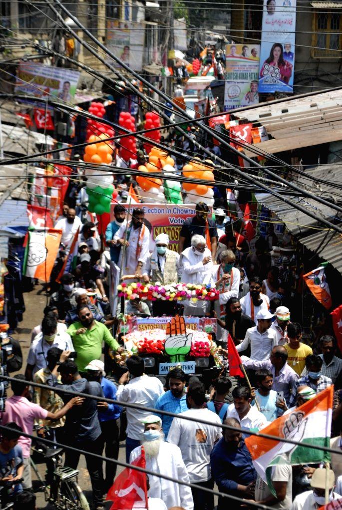 Left Front Chairman Biman Basu, State Congress president Adhir Ranjan Chowdhury along with Sanjukta Morcha candidate of Chowringhee constituency Santosh Pathak at a road show during the ... - Biman Basu and Santosh Pathak