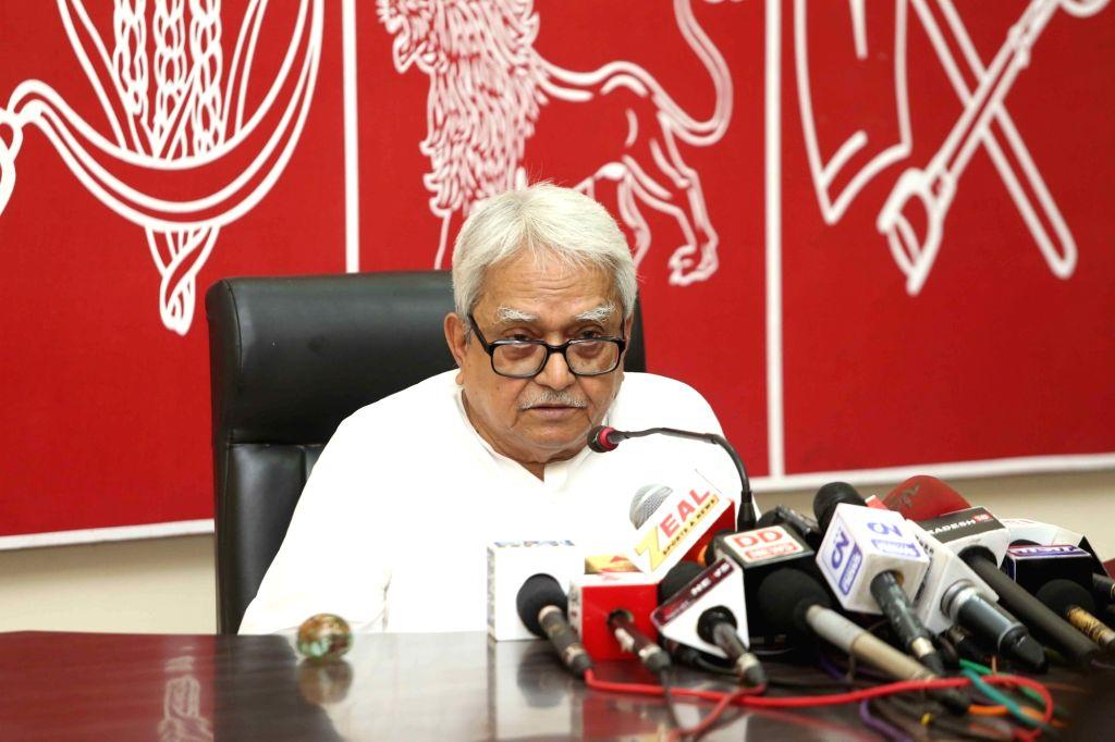 Left Front Chairman Biman Bose addresses a press conference in Kolkata on Aug 13, 2016. - Biman Bose