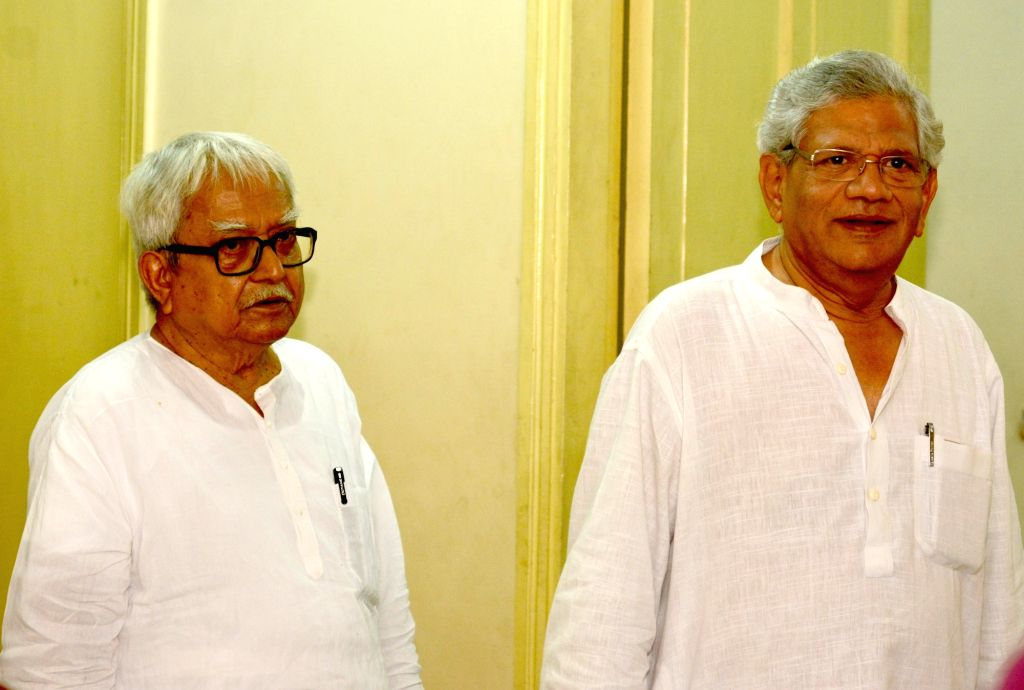 Left Front Chairman Biman Bose and CPI-M General Secretary Sitaram Yechury arrive to address a press conference, in Kolkata on April 26, 2019. - Sitaram Yechury and Biman Bose
